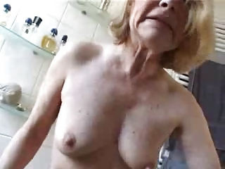 This cute granny really loves black cock. Amateur home made